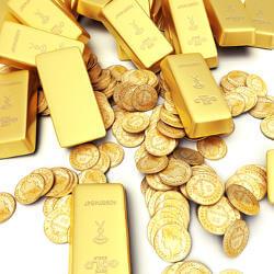 Bild zeigt Goldbarren und Münzen