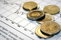 Aktienkurs und Geldmünzen