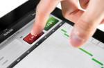 Bild zeigt ein Tablet, auf dem ein Verkauf abgeschlossen wird